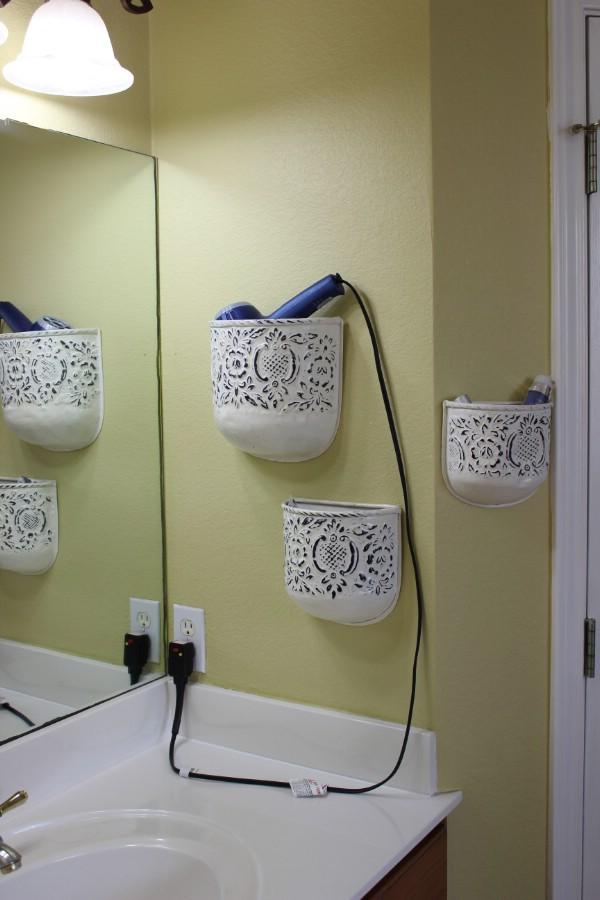 Saç kurutma makinası için tutacak