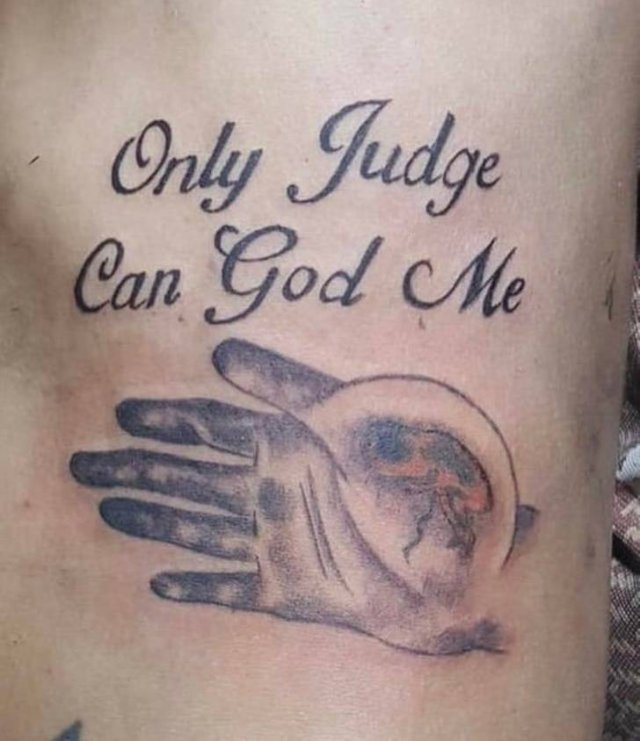 only judge can god me dövmesi